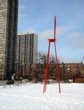 Silla roja grande en nieve Imagenes de archivo