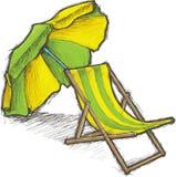 Silla y parasol rayados de playa Fotografía de archivo libre de regalías