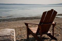 Silla y playa Fotos de archivo