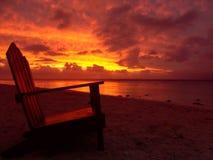 Silla y puesta del sol Fotografía de archivo libre de regalías