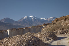 Sillar stone quarry and volcano Chachani in Arequipa Peru. Royalty Free Stock Image