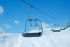 Sillas de la elevación de esquí Fotografía de archivo