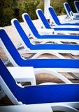 Sillas de la piscina Imágenes de archivo libres de regalías