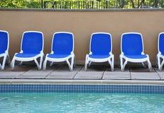 Sillas de la piscina Imagen de archivo libre de regalías