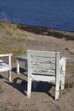 Sillas de madera en la playa Imagen de archivo libre de regalías