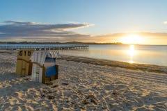 Sillas de mimbre de la playa europea Imagen de archivo libre de regalías