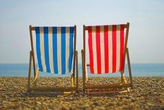 Sillas de playa coloridas Imágenes de archivo libres de regalías