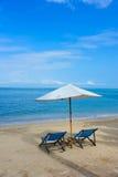 Sillas de playa en la arena Imágenes de archivo libres de regalías