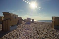 Sillas de playa en la playa en la luz del sol Imágenes de archivo libres de regalías
