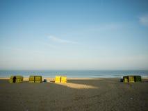 Sillas de playa en la puesta del sol Fotografía de archivo