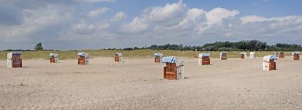Sillas de playa encapuchadas Fotografía de archivo libre de regalías