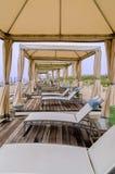 Sillas de playa Unnder el toldo Imágenes de archivo libres de regalías