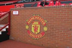 Sillas del equipo local en el estadio viejo de Trafford Fotografía de archivo libre de regalías
