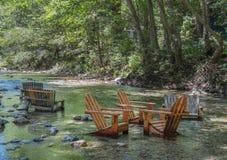 Sillas en el río Foto de archivo libre de regalías