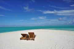 Sillas en la playa Fotografía de archivo libre de regalías