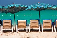 Sillas plásticas en la playa Foto de archivo libre de regalías