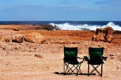 sillas que acampan foto de archivo