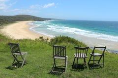 Sillas que pasan por alto la playa Australia de Congo Imágenes de archivo libres de regalías