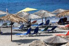 Sillas y parasoles de playa Fotografía de archivo libre de regalías