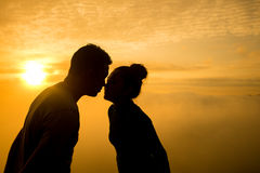 Sillhouette couple love. Silhouette of couple love on the mountain sunrise stock photo