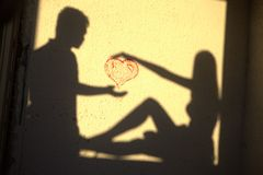 Sillhouette loving couple heart. Sillhouette loving couple making heart Stock Photography