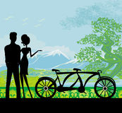 Sillhouette of sweet young couple in love standing in the park Stock Image