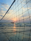 Sillhouette of a volleyball net against sunset on the beach Royalty Free Stock Photos