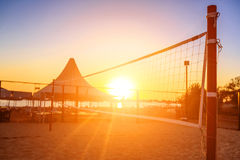 Sillhouette of a volleyball net and sunrise on the beach Royalty Free Stock Images