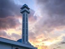 Sillohuette de nuage de l'Islam de coucher du soleil de minaret Image libre de droits