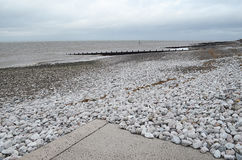 Silloth coastline,Cumbria. Pebbles on Silloth Beach,Cumbria on a cold day Royalty Free Stock Images