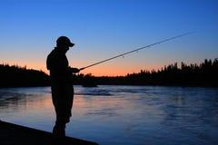 Sillouette渔夫 免版税图库摄影