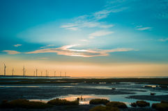 Sillouette di parco eolico Fotografia Stock