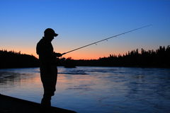 Sillouette fisherman. Fishing the kenai river in Alaska at dusk Royalty Free Stock Photography