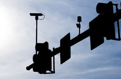 Sillouette of Traffic Light Cluster Including Traffic Camera Stock Images