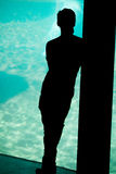 Sillouette of young boy day dreaming of the sea Royalty Free Stock Image