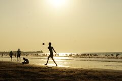 Silluhette of Man Playing Ball Near the Seashore Royalty Free Stock Photo