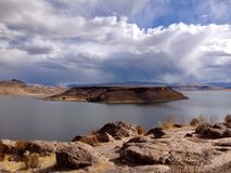Sillustani and Lake Umayo near Puno, Peru. View of Lake Umayo from Sillustani on a sunny day near Puno, Peru Royalty Free Stock Photos