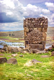 Sillustani - pre-Incan burial ground (tombs) on the shores of La Royalty Free Stock Photography