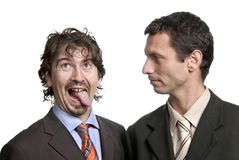 Silly. Two young silly business men portrait on white Royalty Free Stock Photo