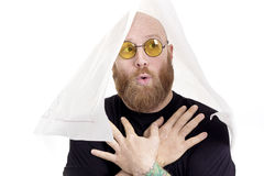 Silly bald man with red beard and crossed eyes Stock Photo