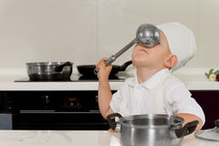 Silly boy with ladle in his face Royalty Free Stock Image