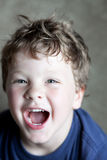 Silly boy laughing looking up Royalty Free Stock Photos