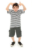 Silly Boy Making Goofy Faces and Gestures Royalty Free Stock Photos