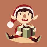 Silly Cartoon Elf Holding a Wrapped Git Box Royalty Free Stock Photo