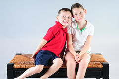 Silly children on bench stock image