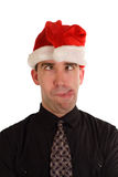 Silly Christmas Employee. An employee making a funny face while wearing a Christmas hat Royalty Free Stock Images