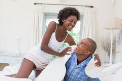 Silly couple having fun on bed together Stock Photography