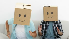 Silly employees with boxes on their heads doing the robot. In creative office stock footage