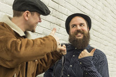 Silly Enemies. Two silly enemies great through clenched teeth Stock Images