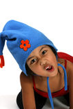 Silly face. Young girl with hat making silly face royalty free stock image
